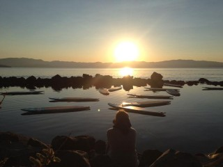Watching the sunrise over Lake Tahoe for Rick's 6 am SUP Yoga Class.